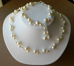 NEW Perle e Cristalli Bridal Set - Swarovski Pearl Necklace with Matching Bracelet and Dangle Earrings. via Etsy.