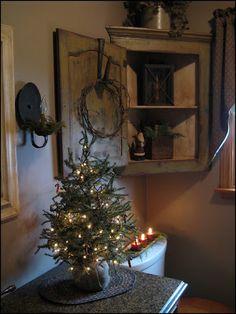 Love this primitive bathroom corner cabinet! Cute decor for half bath Primitive Christmas Decorating, Prim Christmas, Country Christmas, Christmas Decorations, Christmas Trees, Xmas, Prim Decor, Country Decor, Rustic Decor
