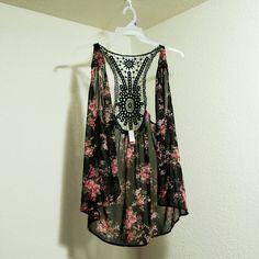 Short flowered sheer vest RE-POSH (too small) Short flowered sheer vest. Xhilaration Tops Tank Tops