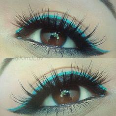Bright turquoise and bold black eyeliner.