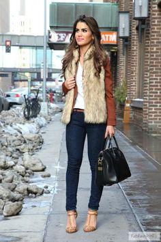 Fall / Winter - street chic style - layers - white v-neck top + brown leather jacket + brown faux fur vest + dark denim skinnies + brown belt + brown studded pumps + black handbag