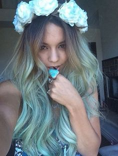 """Vanessa Hudgens debuts turquoise hairWhat better way to update the ombre trend than with a big splash of color? A flower-topped Vanessa Hudgens shared this photo on Instagram over the weekend, showing off the newly turquoise-ified tips of her long locks of hair. Alongside the photo, she implied that her new look had a literary inspiration.""""She would be half a planet away, floating in a turquoise sea, dancing by moonlight to flamenco guitar,"""" Hudgens wrote, quoting Janet Fitch in """"White ..."""