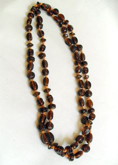 "B8783 £23 or offer INC POST. A long vintage shaped brown glass bead necklace measuring approximately 40"" long with no catch.  Quite heavy at almost 86g. Believed to date from the first part of the last century but not absolutely certain."