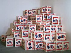 Andy Warhol - Brillo Boxes = Art as a mirror: this is your world, and Warhol is mirroring it back to you. Stacks and stacks of icons, that's what you see in the supermarket.