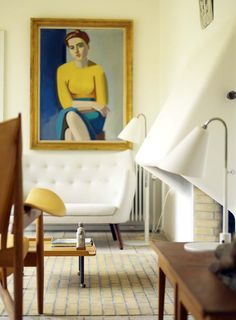 FINN JUHL, Juhl's private home in Kratvænget, Charlottenlund, Denmark, built it 1942. Nowadays a museum and open for public. Fromt the left: Chieftain Chair (Høvdingestolen, 1949), Poet sofa (1941) both by Finn Juhl, painting Portrait of Hanne Wilhelm Hansen by Vilhelm Lundstrøm (1946).