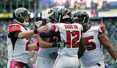 Falcons vs. Seahawks:    October 16, 2016  -  26-24, Seahawks  -   Atlanta Falcons quarterback Matt Ryan (2) runs to greet wide receiver Mohamed Sanu (12) after Sanu scored a touchdown in the second half of an NFL football game against the Seattle Seahawks, Sunday, Oct. 16, 2016, in Seattle.