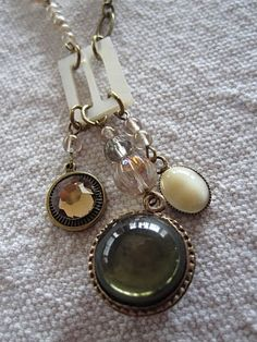 necklace using vintage buckle with dangles.