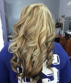 Golden blonde hair, heavy light blonde highlight, with caramel and brown lowlights