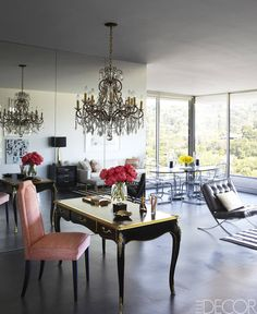 love the feminine mix here of MCM w/reflective/mirrored & classical/gilded pieces it affords an overall mid 20th century Hollywood Regency vibe... producer Ellen Rakieten's Hollywood Home- ELLE DECOR