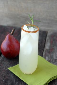 Ginger Pear Snap - Pear Vodka, Ginger Liqueur, Lemon Juice, Ginger, Rosemary Sprig, Rhubarb Bitters, Pear Soda, Gingerbread Spice for Rim.