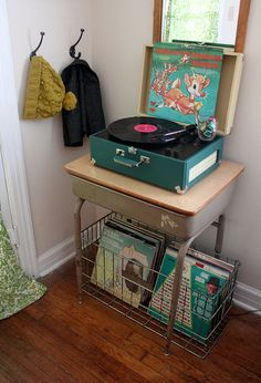school desk And vintage record player! I have a very similar record player in red, it's currently sitting on an old sea green tin trunk but I love how this one is displayed