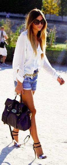 Simple and chic in denim cutoffs, a white button down and strappy sandals.
