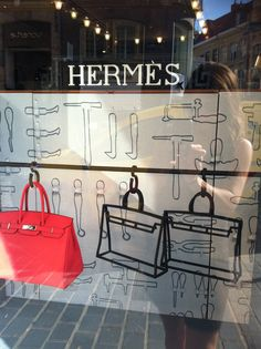 Hermes window. #millinery #judithm #windowdisplay Try this with a hat and sketches of a hat. Along with sketches of hatmaking tools on the background.