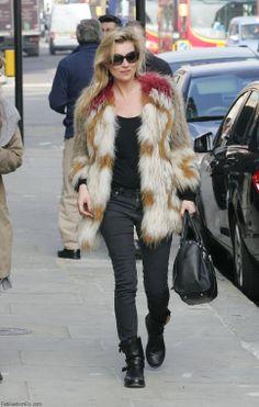 Kate Moss wearing fur coat.