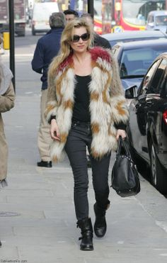 Kate Moss wearing fur coat.
