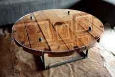 Wooden cable spool tables: DIY projects and ideas. This one done with a Glass top and a Plumbing pipe base.