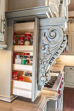 Not just for decoration anymore -- ornate moldings pull out to reveal hidden pantry storage! Good, sneaky idea for hidden storage. Hidden Shelf, Hidden Pantry, Hidden Storage, Hidden Kitchen, Extra Storage, Hidden Safe, Secret Storage, Storage Place, Kitchen Small