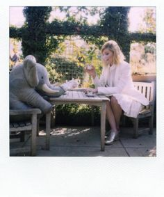 Kirsten Dunst sitting at our Lennox chair and table set - www.countrycasual.com