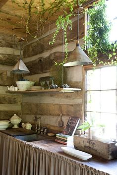 Rustic kitchen with vintage lighting// Garden and Gun