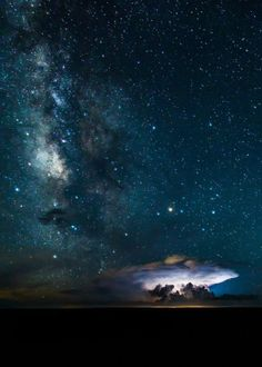 Milky Way over the Grand Canyon as lightning illuminates a cloud, By Brendan Hall