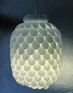 Lamp shade made from recycled plastic spoons and a bottle
