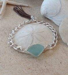 Sharon DeAngelo's Sea Glass Creations.  Each piece of sea glass in my collection was time-tumbled by the Atlantic Ocean, found on the shores of New England then personally hand-selected for its quality and color to be used in my original sea glass jewelry designs.