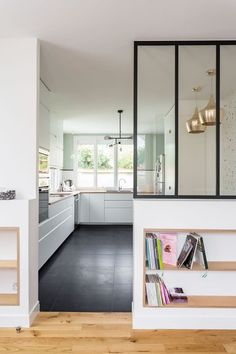 Maison Saint Maur des fossés : aménager les combles A canopy of workshop opens the kitchen on the entrance New Homes, Home Decor Kitchen, Interior Windows, Home Decor Inspiration, Home Living Room, Kitchen Interior, Trendy Home, Home, Home Decor