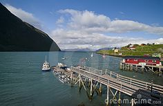 A small Norwegian fishing port with a single jetty and boats moored. Koppangen, northern Norway.