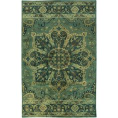 Make a stylish statement in the living room or anchor bohemian decor in the master suite with this hand-tufted wool and cotton rug, showcasing an ornate meda...