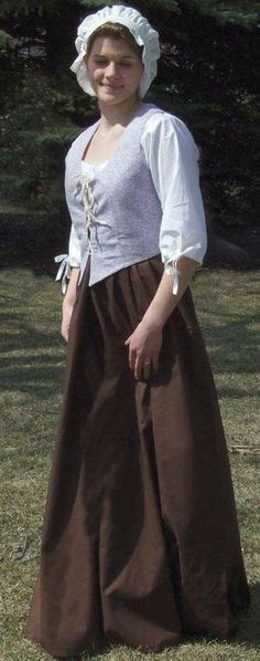 the clothing these ladies wore during the witch trial era were very simple since they were humble. It was homespun and home woven. As the picture shows, the clothing were long sleeved, long with a white cap