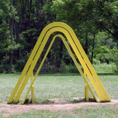 """Bench Around the Lake"" by Jeppe Hein - photo from visualingual;  one of 15 benches in the '100 Acres' at The Indianapolis Museum of Art in Indiana;  Not all of the bendy benches are ""sit-able"" – this one is ""lean-able."""