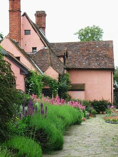 Suffolk pink cottage. My Dad's family farm farmhouse in Suffolk is this colour.