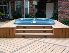 Love the lighted steps leading up, but wouldn't put the deck all the way around it.