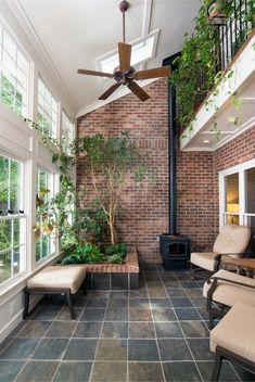 indoor planting idea traditional sunroom floor tile fireplace brick walls chairs windows ceiling fan of Wonderful Indoor Planting Idea Choices to Choose From Rustic Sunroom, Small Sunroom, Wall Garden Indoor, Indoor Balcony, Indoor Sunrooms, Red Brick Fireplaces, Tile Fireplace, Screened Porch Designs, Tile Bedroom