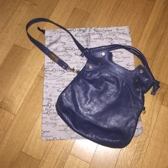 """Foley & Corinna navy blue large bag Navy blue with gold hardware foley & Corinna bag! Beautiful in great condition only worn 3 times comes with dust bag and authentic card signs of wear on gold foley & Corinna gold bar ... All zippers work! Any questions please ask the bag is about 13"""" wide ... From top of handle to bottom of bag it is almost 18""""... When bag is folded closed to wear on your side it is about 10"""" ... Foley + Corinna Bags Crossbody Bags"""