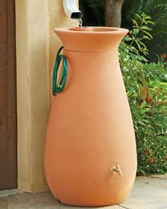 A rain barrel is an ideal rain water harvesting system. But what should you look for in a rain barrel? And what can you safely do with stored rain water? Discover the facts about rain water harvesting with a rain barrel. Rain Water Barrel, Rain Barrel Stand, Rain Catcher, Water From Air, Magic Garden, Water Collection, Rainwater Harvesting, Garden Supplies, Container Gardening