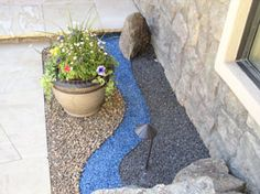 adding color to landscaping now I know what to do with those extra aquarium rocks