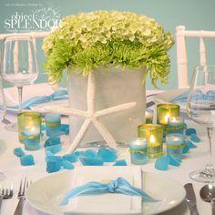 Beach wedding centerpiece with white finger starfish.