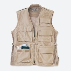 Travel Vest  airy, cottonlike nylon with advanced performance characteristics and Teflon® protection, it's a quick-drying wrinkle-, stain-, and water-resistant wonder that keeps necessities close and packs away into almost nothing. Nineteen separate pockets (including a secret security pocket) can hold a water bottle, passport, travel tickets, cell phone, maps, film, and personal stereo. Complemented by camera and binocular epaulets with slip-resistant grips, adjustable side cinches, and…