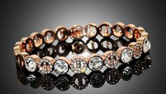 Rose Gold Tone Pave Bracelet Make a shimmering statement with the Rose Gold Tone Pave Bracelet      Features sparkling zirconia crystals set in rose gold tone metal      Crystals alternate between solid and smaller rings      Bracelet measures approximately 6.8cm      Fastens with a super safe fold-over ladder clasp      Ideal for adding an extra special shine to your outfits      Save 85%...