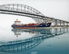 What a beautiful capture by photographer Robert Powers ... the doubled images of the Algocanada and the Blue Water bridge ... Michigan
