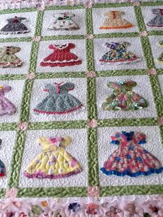 Love this!! Quilt blocks with dresses appliqued on them. Very colorful. Sweet for a little girls room.