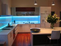 Spice up the way your Kitchen looks like. Bring some color with this LED Kitchen Lighting concept using LED strips or under cabinet lights (http://saltoweb.biz)