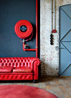 love the door color even more than the wall, though all seem to work together  Red sofa blue wall