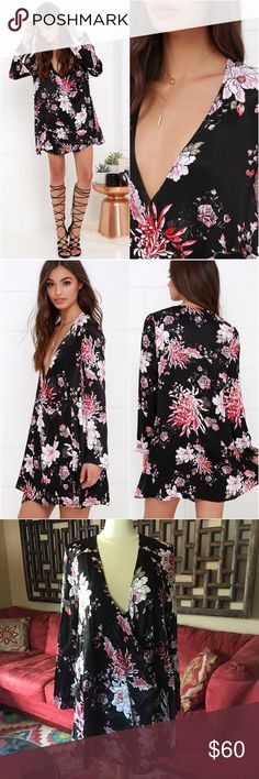 Somedays Lovin' Flora Kimono Wrap Dress Slip into the Somedays Lovin' Flora Black Floral Print Dress for a look that will rival the beauty of the Kyoto Gardens! Black satin fabric (decorated with breathtaking blooms in shades of pink) shapes a cool, kimono-inspired dress with long sleeves. The sultry plunging neckline (with modesty snap) transitions into a wide-cut, wrap bodice that buttons at the side. Interior button closure.   Worn once. Like new condition.  Unlined  100% Viscose Hand…
