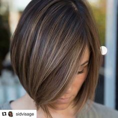 Like the color with subtle highlights/balayage on this straight brunette bob with side part