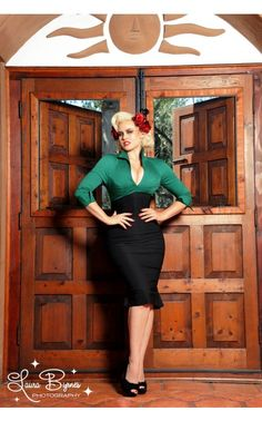 For the woman who is as tough as nails, but also likes them manicured. The Lauren is a striking and savvy dress is designed to take you effortlessly from work to play. The structured deep emerald green sateen top with its plunging v-neckline is lined and is attached to a curve-loving and comfortable black bengaline skirt.