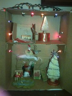 This is my mini Christmas house I made with my mom & dad. We had a little trouble with the santa, because when we tried to put the needle through his head to get the string through, and we had to use pliers to get it out.