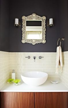The pretty tile, the walnut cabinet, the dark wall, the mix of simple and ornate - this bathroom is perfect