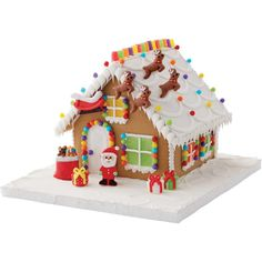 Finish decorating your gingerbread house with this Santa & Reindeer Gingerbread House Decorating Kit. Includes: Santa Claus, sleigh, sack of presents, 3 gifts and 4 reindeer icing decorations. Net weight: 0.95 oz.